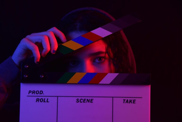 Girl with a clapperboard on how to take action