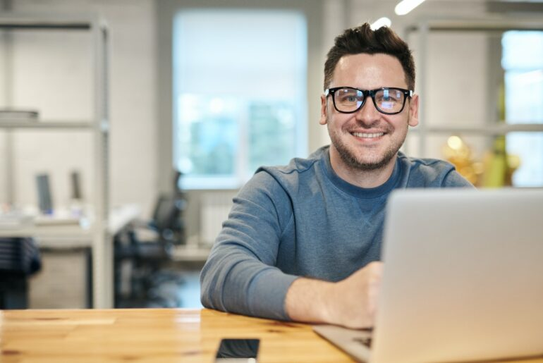 Happy man working for Highest paying tech jobs
