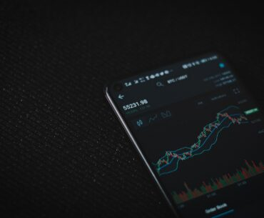Passive income sources and investing using a smartphone where graphs are shown