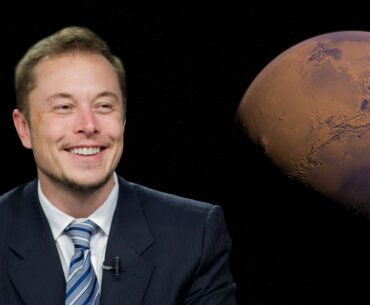 Elon Musk in blue suit smiling while image of mars shows behind