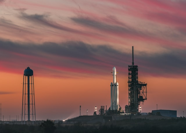 SpaceX launchpad with pink sky behind